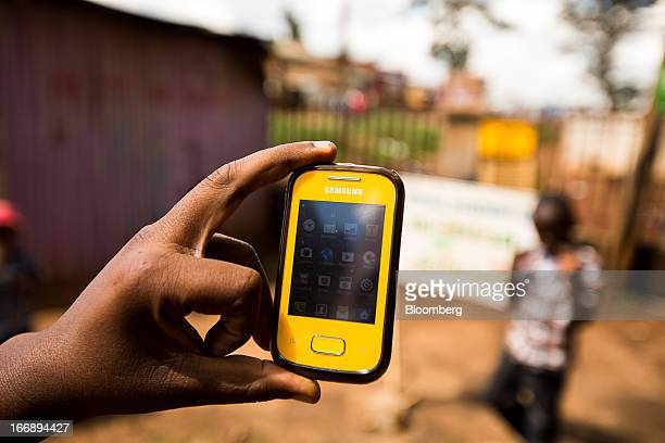 A Samsung Electronics Co mobile phone is displayed for a photograph in Nairobi Kenya on Sunday April 14 2013 In the six years since Kenya's MPesa...