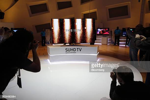 A Samsung Electronics Co Ultra Slim SUHD Quantum dot display television is displayed during an event at the 2016 Consumer Electronics Show in Las...