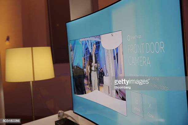 A Samsung Electronics Co Ultra Slim SUHD Quantum dot display television with SmartCam HD Pro front door camera enabled is displayed during an event...