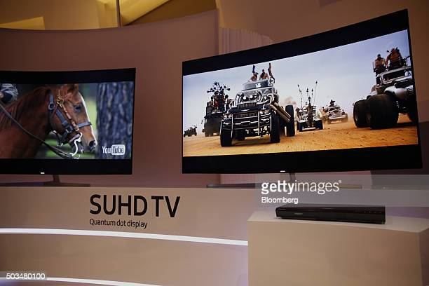 A Samsung Electronics Co Ultra Slim SUHD Quantum dot display television and Ultra High Definition BluRay Player are displayed during an event at the...