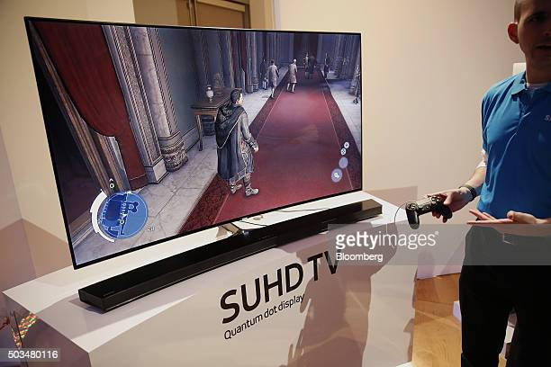 A Samsung Electronics Co Ultra Slim SUHD Quantum dot display television with consoleless gaming is displayed during an event at the 2016 Consumer...
