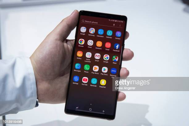 Samsung employee displays the new Samsung Galaxy Note 9 smartphone during a product launch event at the Barclays Center August 9 2018 in the Brooklyn...