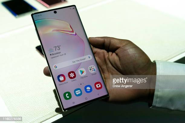 Samsung employee holds the new Samsung Galaxy Note 10 smartphone during a launch event at Barclays Center on August 7 2019 in the Brooklyn borough of...