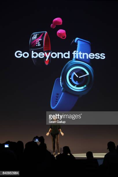 Samsung employee Kate Beaumont presents products from the company's new wearables collection including the Gear Sport watch the Gear IconX 2018 ear...