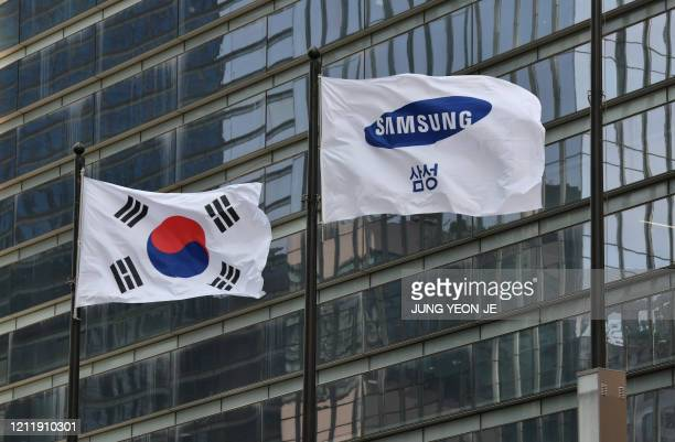 Samsung flag and South Korean national flag flutter outside the company's Seocho building in Seoul on May 6, 2020. - The heir to the Samsung empire...
