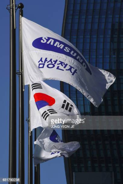A Samsung flag and South Korean national flag flutter outside the Samsung group headquarters in Seoul on January 16 2017 South Korean prosecutors on...