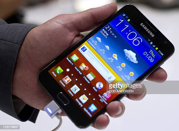 A Samsung Galaxy Note bigger than a smart phone but smaller than any previous tablet is seen after it's launch at press conference at the 51st...