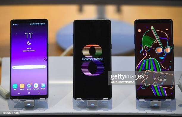 Samsung Galaxy Note8 smartphones are displayed at the company's showroom in Seoul on October 31 2017 South Korean tech giant Samsung Electronics...