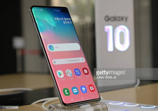 Samsung Galaxy S10+ smartphone is displayed at a telecom shop in Seoul on April 30, 2019. - Samsung Electronics, the world's biggest smartphone and...
