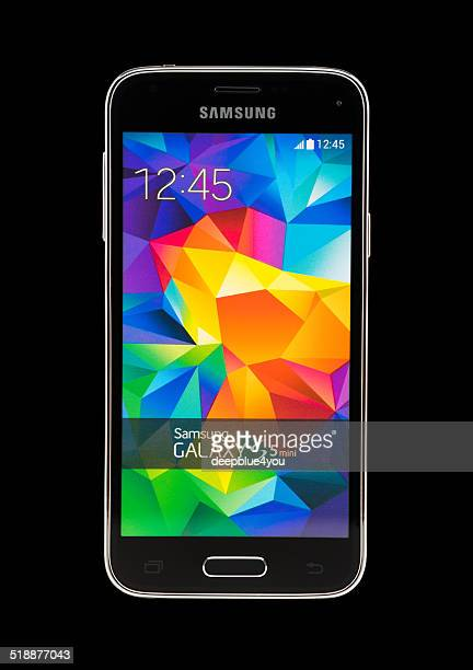 samsung galaxy s5 mini on black background - samsung galaxy s stock pictures, royalty-free photos & images