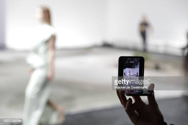 Samsung Galaxy Z Flip is used to film the Christopher Esber show during Afterpay Australian Fashion Week 2021 Resort '22 Collections at Carriageworks...