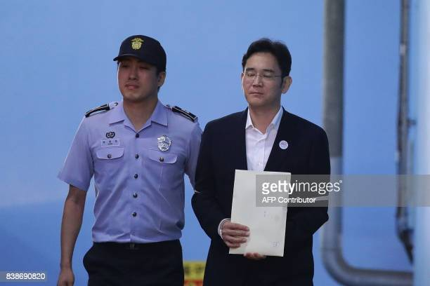 TOPSHOT Samsung Group heir Lee Jaeyong leaves the Seoul Central District Court following his verdict in Seoul on August 25 2017 The heir to the...