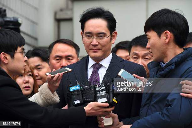 Samsung Group's heirapparent Lee JaeYong leaves for a waiting facility after attending a court hearing on whether he will be issued with an arrest...