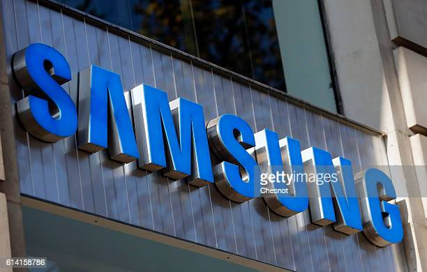A Samsung logo is displayed on the facade of a Samsung Partnershop retail store on October 12 2016 in Paris France Less than two months after its...
