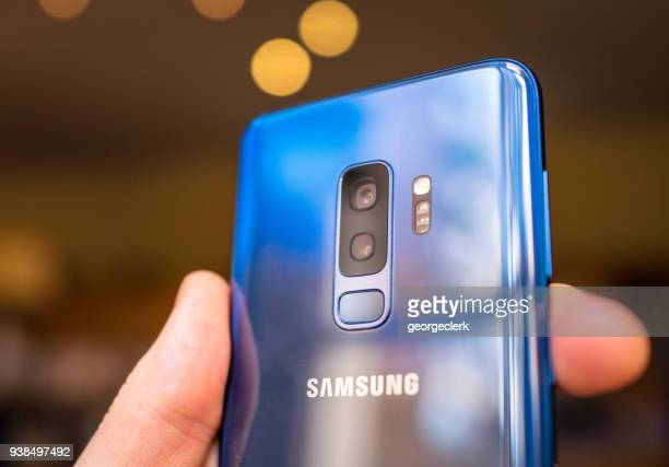 samsung s9+ smartphone's dual camera lenses - photo messaging stock photos and pictures
