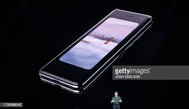 Samsung senior vice president of product marketing Justin Denison speaks on stage about the new foldable phone during the Samsung Unpacked product...