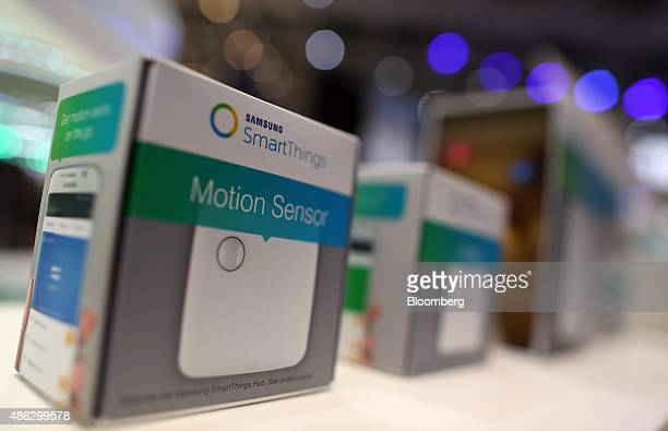 A Samsung Smart Things motion sensor sits on display at the Samsung Electronics Co exhibition stand during previews for the IFA International...