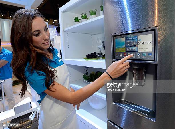 Samsung spokesmodel Kai Madden displays the connectivity feature on a Samsung smart refrigerator at the 2014 International CES at the Las Vegas...