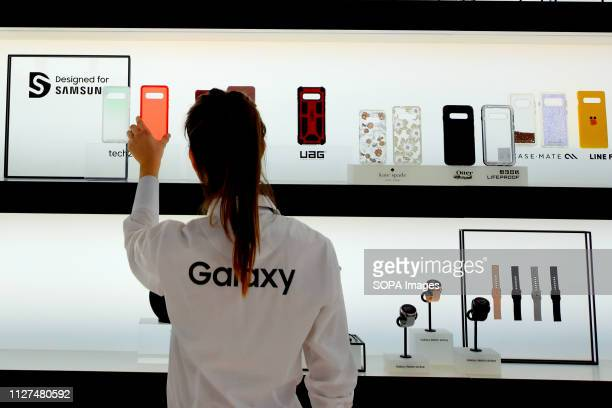 Samsung Staff member seen ordering for the accessories of the new S10 model during the event at the Mobile World Congress in Barcelona
