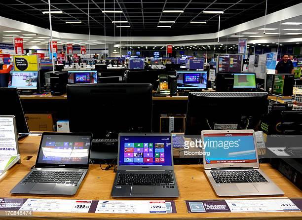 A Samsung Touchscreen Ultrabook left and a Samsung Ultrabook center manufactured by Samsung Electronics Co Ltd sit alongside an Acer Inc Ultrabook...