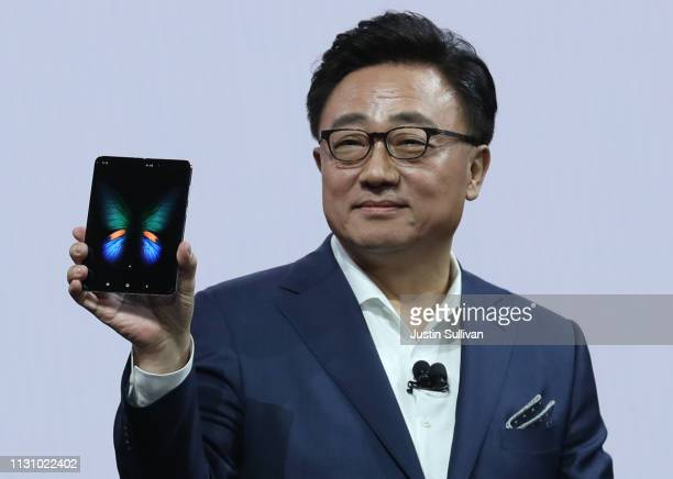 Samsung's Mobile Division President and CEO DJ Koh holds the new Samsung Galaxy Fold smartphone during the Samsung Unpacked event on February 20 2019...