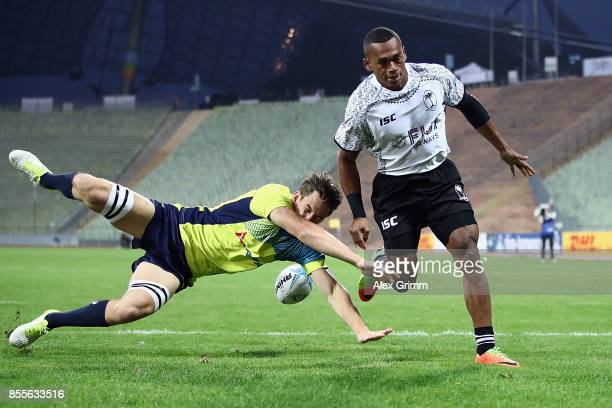 Samu Bale of Fiji scores a try against Lachie Anderson of Australia during the match between Australia and Fiji on Day 1 of the Rugby Oktoberfest 7s...