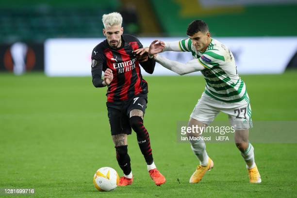 Samu Castillejo Azuaga of AC Milan is tackled by Mohamed Elyounoussi of Celtic during the UEFA Europa League Group H stage match between Celtic and...