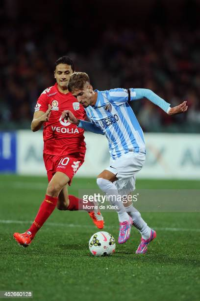 Samu Castillejo of Malaga gets away from Marcelo Carrusca of Adelaide during the international club friendly match between Adelaide United and Malaga...