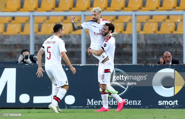 Samu Castillejo of Milan celebrates after scoring the opening goal during the Serie A match between US Lecce and AC Milan at Stadio Via del Mare on...