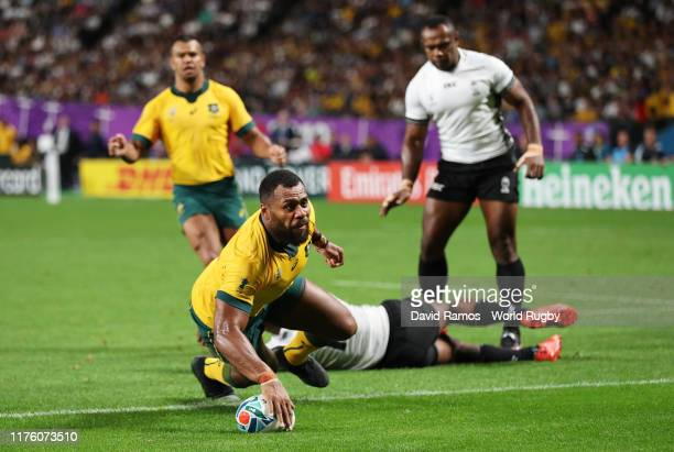 Samu Kerevi of Australia grounds the ball to score his side's fifth try during the Rugby World Cup 2019 Group D game between Australia and Fiji at...