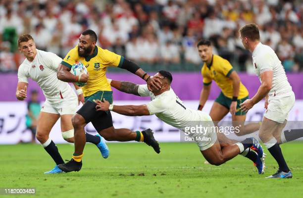 Samu Kerevi of Australia hands off Manu Tuilagi of England during the Rugby World Cup 2019 Quarter Final match between England and Australia at Oita...