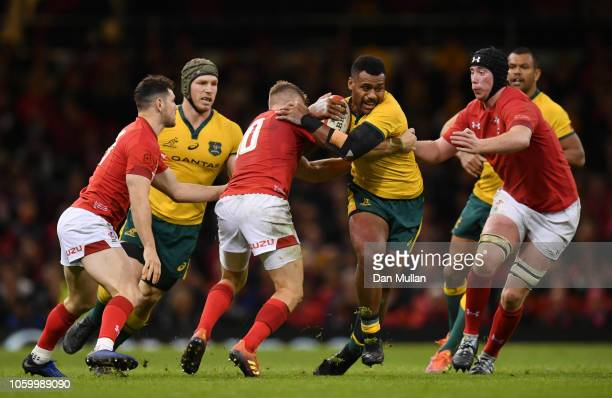 Samu Kerevi of Australia is tackled by Gareth Anscombe of Wales during the International Friendly match between Wales and Australia at Principality...