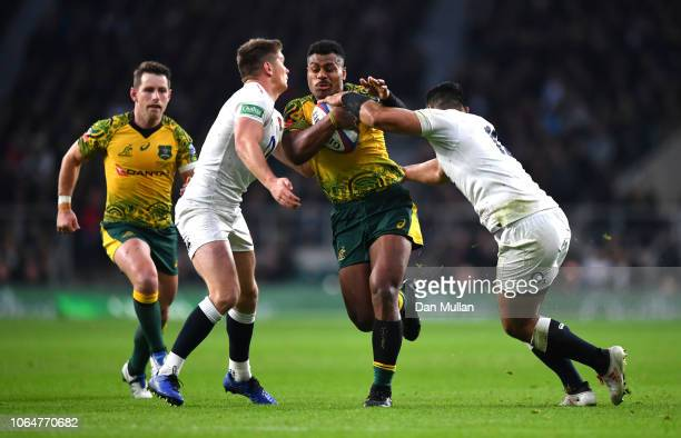 Samu Kerevi of Australia is tackled by Owen Farrell of England and Ben Te'o of England during the Quilter International match between England and...