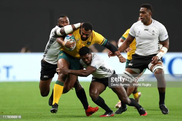 Samu Kerevi of Australia is tackled during the Rugby World Cup 2019 Group D game between Australia and Fiji at Sapporo Dome on September 21, 2019 in...