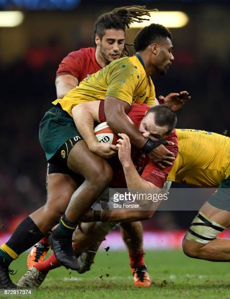 Samu Kerevi of Australia tackles Ken Owens as Josh Navidi looks on during the Under Armour Series match between Wales and Australia at Principality...