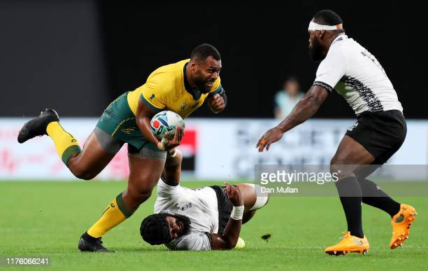Samu Kerevi of Australia takes on Levani Botia of Fiji during the Rugby World Cup 2019 Group D game between Australia and Fiji at Sapporo Dome on...