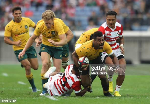 Samu Kerevi of Australia takes on the Japan defence during the rugby union international match between Japan and Australia Wallabies at Nissan...