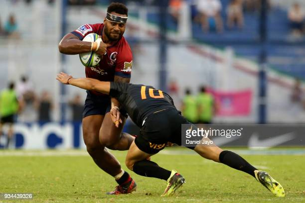Samu Kerevi of Reds is tackled by Nicolas Sanchez during a match between Jaguares and Reds as part of the fifth round of Super Rugby at Jose...