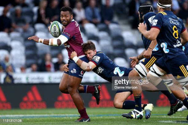 Samu Kerevi of the Queensland Reds is tackled by Teihorangi Walden of the Highlanders during the Round 2 Super Rugby match between the Otago...