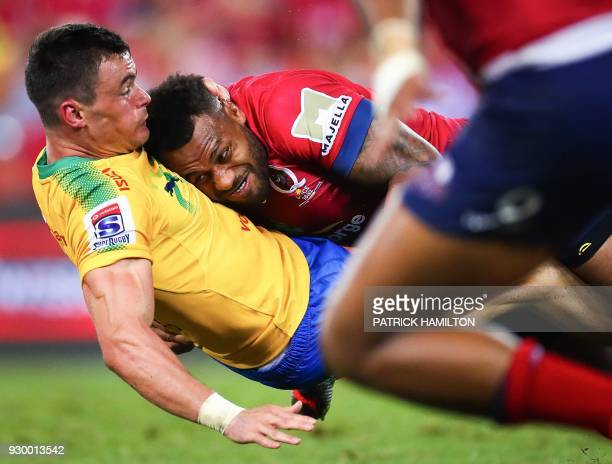 TOPSHOT Samu Kerevi of the Queensland Reds tackles Northern Bulls' Jesse Kriel during the Super Rugby match between Australia's Queensland Reds and...