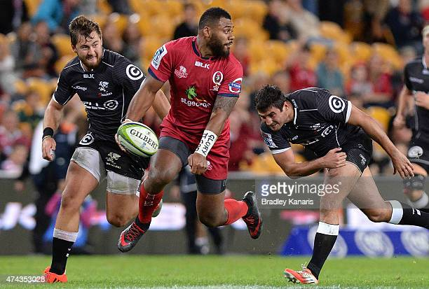 Samu Kerevi of the Reds breaks away from the defence during the round 15 Super Rugby match between the Reds and the Sharks at Suncorp Stadium on May...