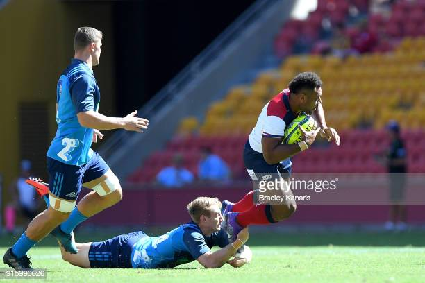 Samu Kerevi of the Reds breaks through the defence during the 2018 Global Tens match between the Reds and the Blues at Suncorp Stadium on February 9...