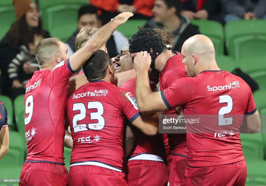 Samu Kerevi of the Reds is congratulated by his teammates after scoring the match-winning try during the round 12 Super Rugby match between the Melbourne Rebels and the Queensland Reds at AAMI Park on May 13, 2017 in Melbourne, Australia.