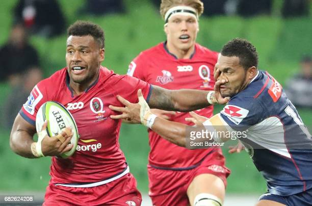 Samu Kerevi of the Reds is tackled by Sefanaia Naivalu of the Rebels during the round 12 Super Rugby match between the Melbourne Rebels and the...