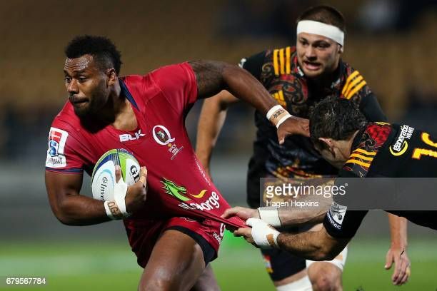 Samu Kerevi of the Reds is tackled by Stephen Donald of the Chiefs during the round 11 Super Rugby match between the Chiefs and the Reds at Yarrow...
