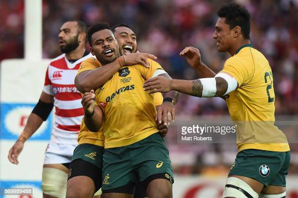 Samu Kerevi of the Wallabies celebrates scoring a try with team mates during the international match between Japan and Australia at Nissan Stadium on...