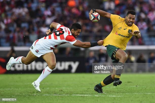 Samu Kerevi of the Wallabies is tackled during the international match between Japan and Australia at Nissan Stadium on November 4 2017 in Yokohama...