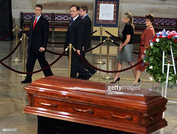 Samuel A Alito Jr walks with Senate Majority Leader Bill Frist past Rosa Parks casket in the Rotunda October 31 2005 in the Capitol building in...