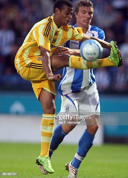 Samuel Adjei in action during a preseason friendly match between Huddersfield Town and Newcastle United at the Galpharm Stadium on July 21 2009 in...
