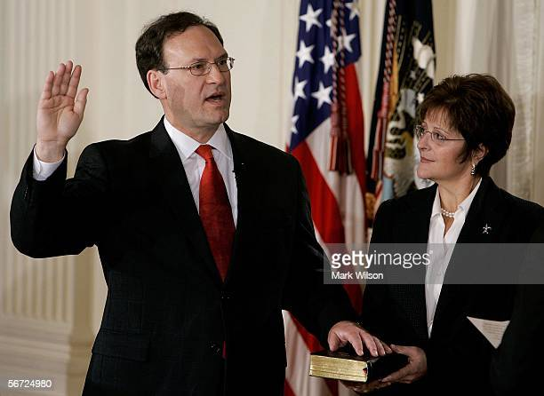 Samuel Alito is sworn in as Associate Justice of the U.S. Supreme Court as his wife Martha-Ann Bomgardner holds a bible during a ceremony in the East...